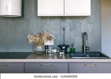 White grey kitchen room organization. Pure water and clear sink