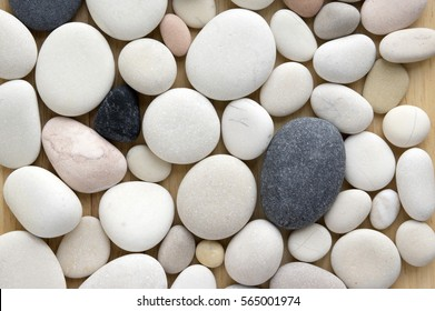 White, grey and pink pebbles background, wooden background, simplicity, daylight, stones