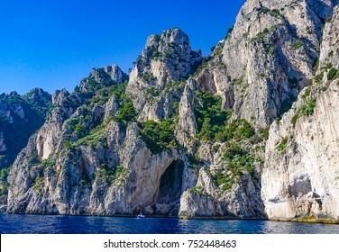 The White Grotto of the island of Capri, Italy.  Coastal Rocks on the Mediterranean Sea at Capri Island from a motor boat tour.