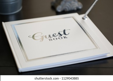 White guest book at wedding reception