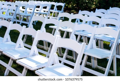 White guest chairs outside in rows