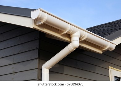 White gutter on the roof top of house.