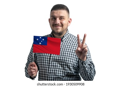 White guy holding a flag of Samoa and shows two fingers isolated on a white background.