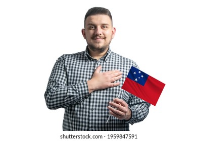 White guy holding a flag of Samoa and holds his hand on his heart isolated on a white background With love to Samoa.