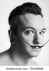 White guy with mustache depicts Salvador Dali