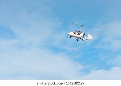 White gyroplane in blue sky