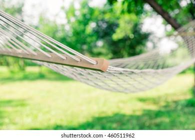 White hammock among the trees