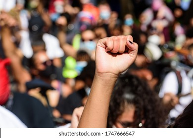 White hand on a black rights demonstration. White and black people together. Anti racism in the USA. Human rights, freedom and justice. Demonstration Fight