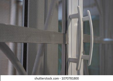 white handle on mesh for mosquito protection background