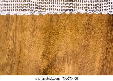 White handmade doily on a wood