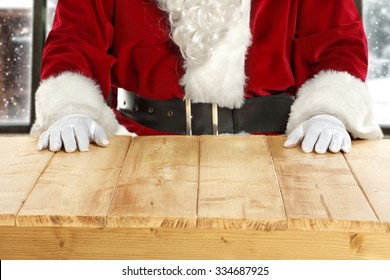 white hands of santa claus and yellow board