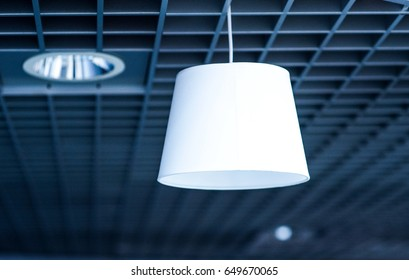 White Hanging lamp on blue blurred background