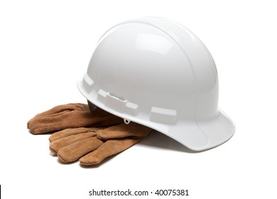 A white hard hat and leather work gloves on a white background