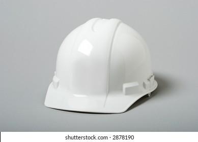 White hardhat on grey background