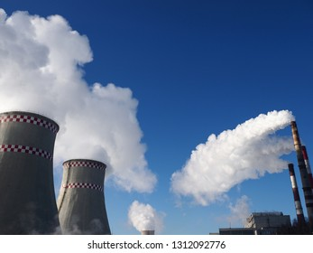 White harmful smog in blue sky vaporing from industrial pipes. Coal electric station produce carbon dioxide environmental health nuclear eco concept