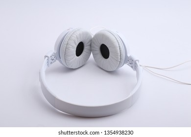 white headphone on white backgroung