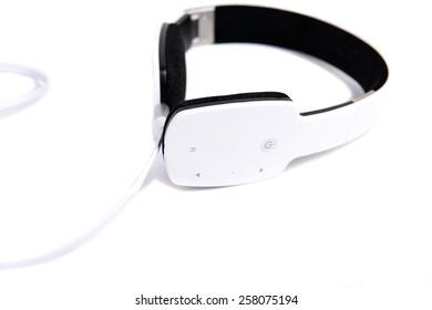 White headphones on white background