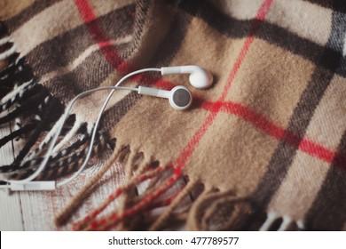 White headphones on the scotland plaid