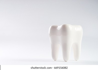 White healthy Tooth isolated on white background with copy space. Oral dental hygiene. Teeth Whitening. Dental health Concept. Oral Care, teeth restoration. Yellow and white teeth.