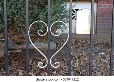 A white heart in a fence