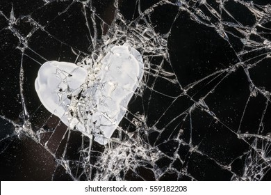 White heart on black broken Touch Screen Phone, background