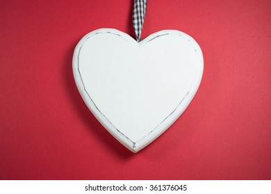 White heart on red background with space for text