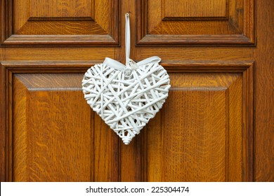 White Heart on wooden Background - Door with Decoration