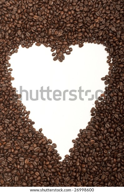 white heart shape arranged in the middle of coffee beans