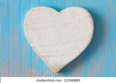white heart shape on wooden board