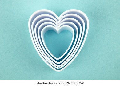 White Hearts isolated on light blue background