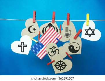 White  hearts,  USA ( America) flag hanging on colorful pegs ( clothespin ) on a line against a blue background.  United States of America  Concept - Religious Freedom Day (January 16)