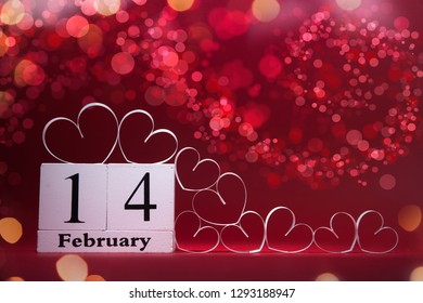 White Hearts and wooden block calendar on red background. Valentines day card. Copy space for your text.