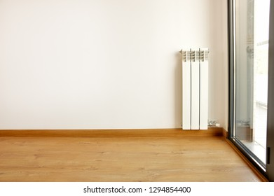 White heating radiator at home with copy space