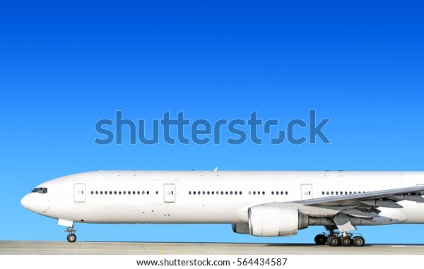White heavy passenger jet engine airplane on runway at airport against blue sky aviation transportation theme background forward nose part silhouette isolated