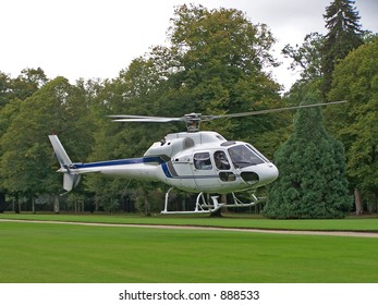 A white helicopter on a field