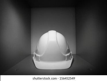 White helmet on grey box