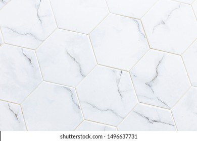 White hexagon marble tile wall for texture background.