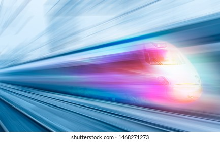 White high speed train runs on rail tracks . Train in motion