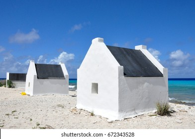 White historic slave houses on Bonaire tropical coastline