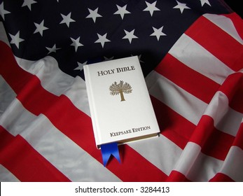 white Holy Bible on american flag