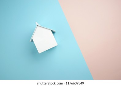 White home replica on top of pastel back gorund
