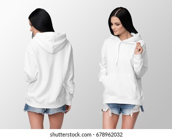 White hoodie on a young woman in shorts, front and back, isolated, mockup.