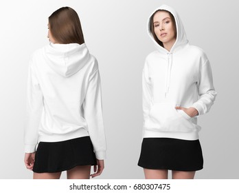 White hoodie on a young woman in black skirt, front and back, isolated, mockup.