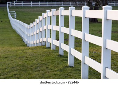 White horse fence on a small farm in the country