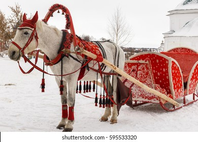 White horse with red wagon
