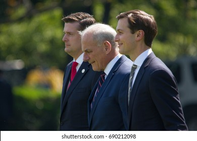 White House aides Rob Porter (L) and Jared Kushner (R) flank newly appointed Chief of Staff Gen. John Kelly while heading to board Marine One, Friday, August 4, 2017.