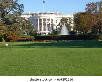 white house backyard lawn and garden