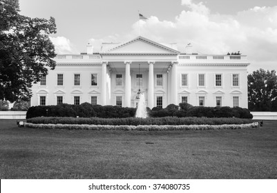 The White House in black and white - The official residence of the President of the United States in Washington, D.C. lit by the setting sun in the evening. Black and white image.