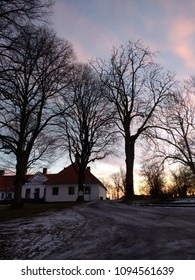 A white house in front of the park. Winter scenery in Larvik, Norway.
