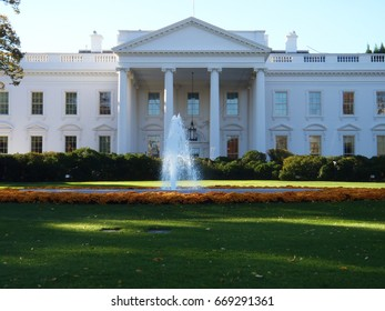 white house front yard lawn and fountain